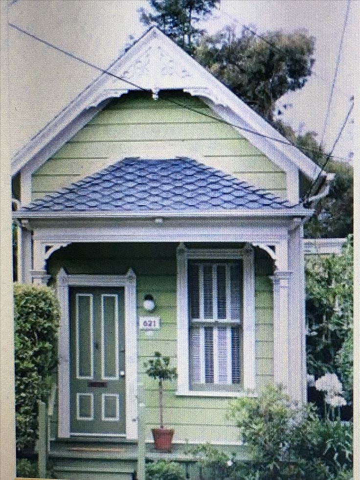 What an adorable, New Orlean shotgun style SHED HOUSE!!! Houses made from from tough sheds do not have to be a man ugly box!!