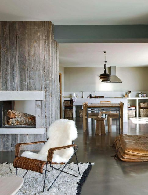 Natural materials in concrete weathered wood in grayish tone gray walls sandy tones