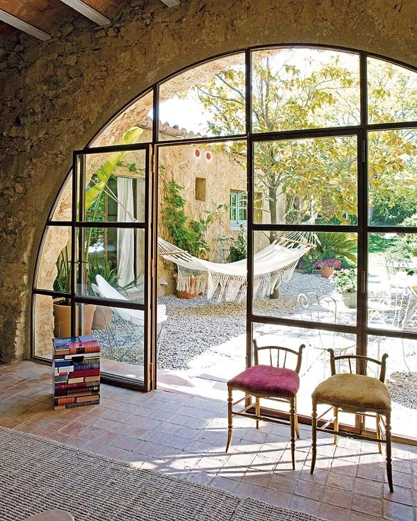 Hotel Les Hamaques, Girona, Spain. Lovely arched window opening onto the garden.