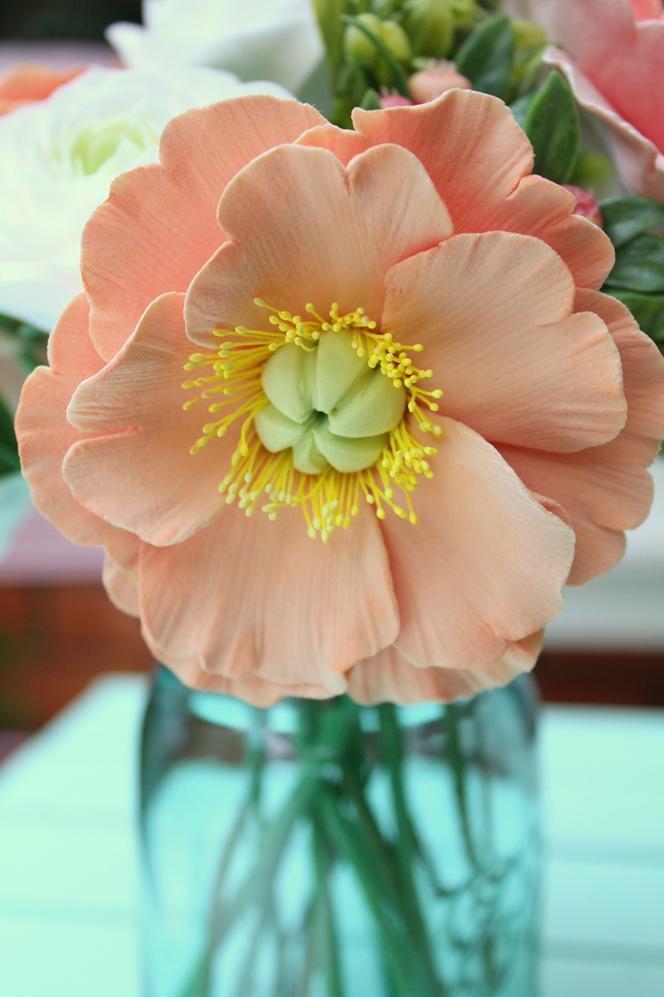 Peachy soft clay poppy. I could never do this in clay! #talent
