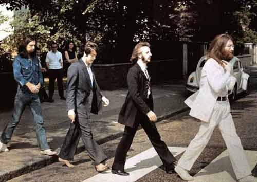 8th Aug 1969, The photo session for the cover of The Beatles 'Abbey Road' album took place on the crossing outside Abbey Road studios. Photographer Iain McMillan, balanced on a step-ladder in the middle of the road took six shots of John, Ringo, Paul, and George walking across the zebra crossing while a policeman held up the traffic. The band then returned to the studio and recorded overdubs on 'The End', 'I Want You (She's So Heavy)' and 'Oh! Darling'. http://youtu.be/hfHO6-tDDqU