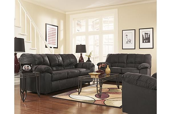 "The Dominator Sofa from Ashley Furniture HomeStore (AFHS.com). With rich earth-toned upholstery and a plush comfort you can really sink into, the ""Dominator-Black"" upholstery collection features thick padded arms and a beautifully detailed stitched bustle back design that makes this collection the perfect fit for any living area."