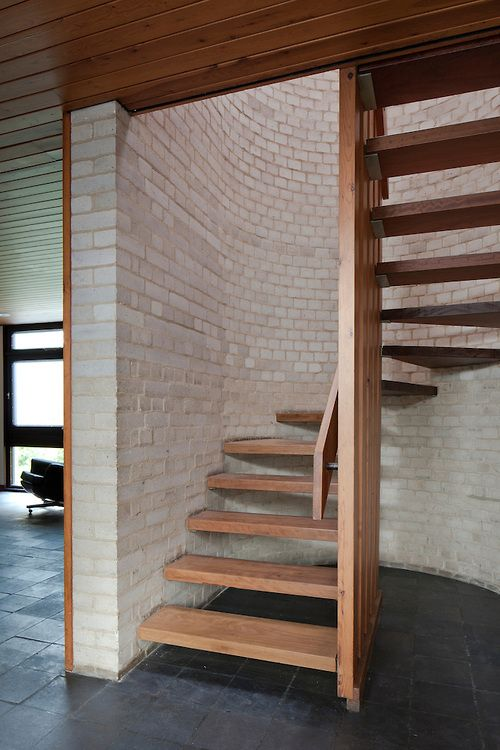 1960s wooden staircase with grey brick wall. I've never been the biggest fan of circular staircase but I dig this!