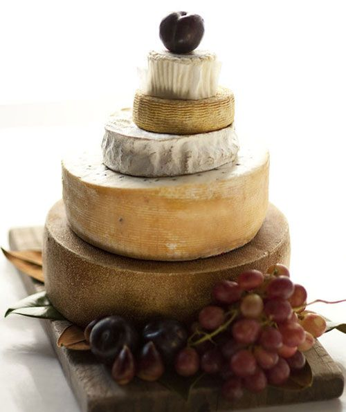 Now here's a first: a wedding cake made completely out of – you guessed it – different flavors of cheese!  This cheese wedding cake is perfect for the couple who prefers a delightful pairing of wine + cheese in lieu of the traditional cake + coffee (or tea).  Pair with your favorite bottles of wine at reception tables for an impromptu wine tasting in your honor.  #CupcakeDreamWedding