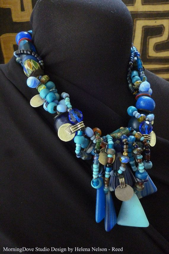 "Blue Moon Festival Tribal inspired necklace by MorningDoveDesign - This design incorporates vintage beads from Africa and Nepal, creating a playful, festive look in colors that cool and refresh the eyes. Some of the beads include the large, antique Dutch trade beads and vintage Czech glass from Africa. 19 inches long, tip to tip. Triangles measure 1.5"" vertical, 1 inch wide at base"