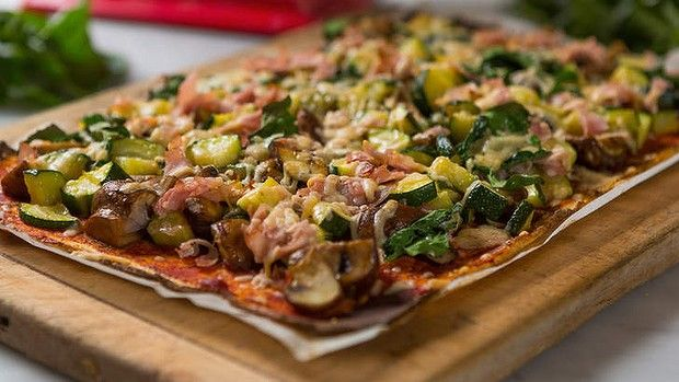 Gluten-free, low-carb cauliflower pizza base with topping.