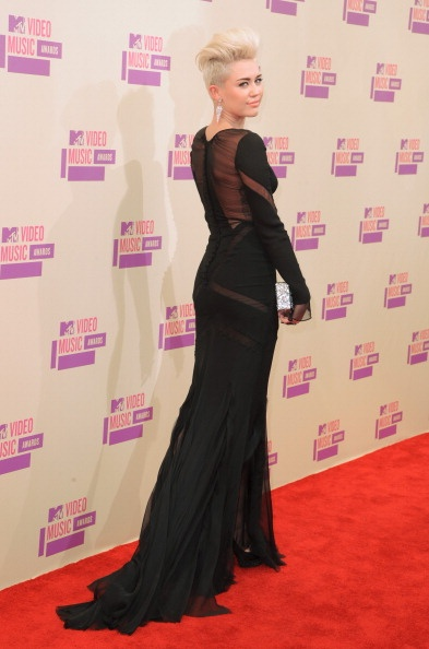 Miley Cyrus wore a very cool long black dress at the VMAs. Check out other ladies who wore long gowns, too.