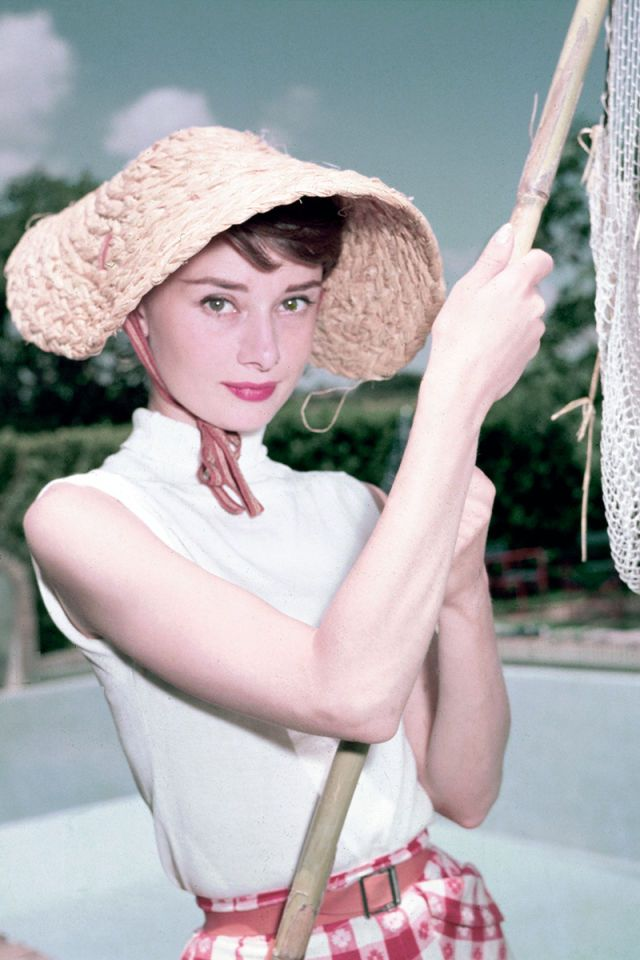 Audrey Hepburn in 1965. See 51 more rare, vintage photos of celebrities enjoying summer.
