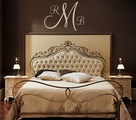 brown monogram above bed