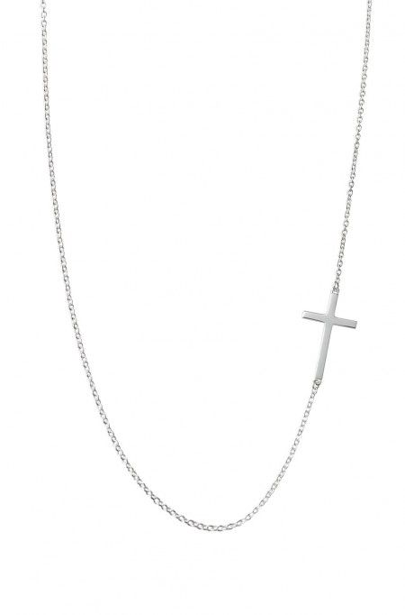 Interlock Cross Necklace by Stella & Dot. Enlarged picture of vertically placed sterling silver cross & chain.