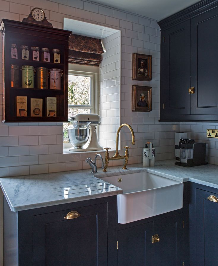 A beautiful Farmhouse sink, deVOL Aged Brass tap and hardware. This dreamy Classic English Kitchen was designed with Interior Designer Imraan Ismail Interiors and photographed by Daniella Cesarei