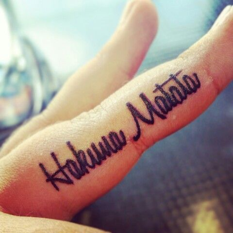 I am so in love with my tattoo! Hakuna Matata! On my inner middle finger. ♡: