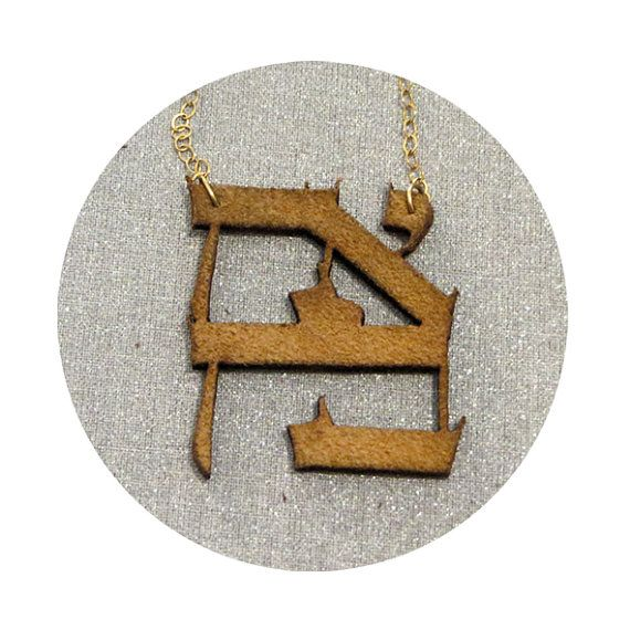 Love Leather necklace, laser cut by maayanhus on Etsy