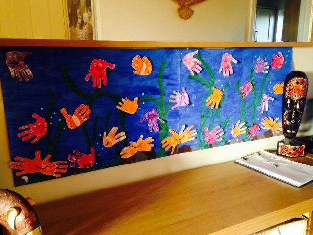 "This is a great idea for a classroom display!  ""This has been done by all of my childminding kiddies and my own child. By their hand and finger prints its in my hallway so when they arrive they always see the fish."""