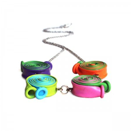 Necklace with rolled multicolored baloons. In this collection, the latex found its leading role and its final and durable destination as it could never happen in reality.