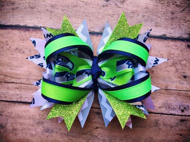 NFL Seahawks stacked bow football 12th Man Shehawks by ShopSassyBabes on Etsy https://www.etsy.com/listing/226017065/nfl-seahawks-stacked-bow-football-12th