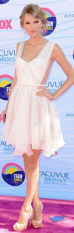 Taylor Swift.  Dress - Maria Lucia Hohan   Jewelry - Lorraine Schwartz   Shoes - Prada   Purse - Edie Parker