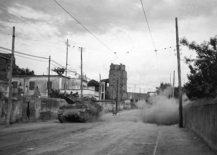 M10 tank destroyer in Rome fires at German machine gun positions from the street. Fifth Army, Rome area, Italy. June 1944.