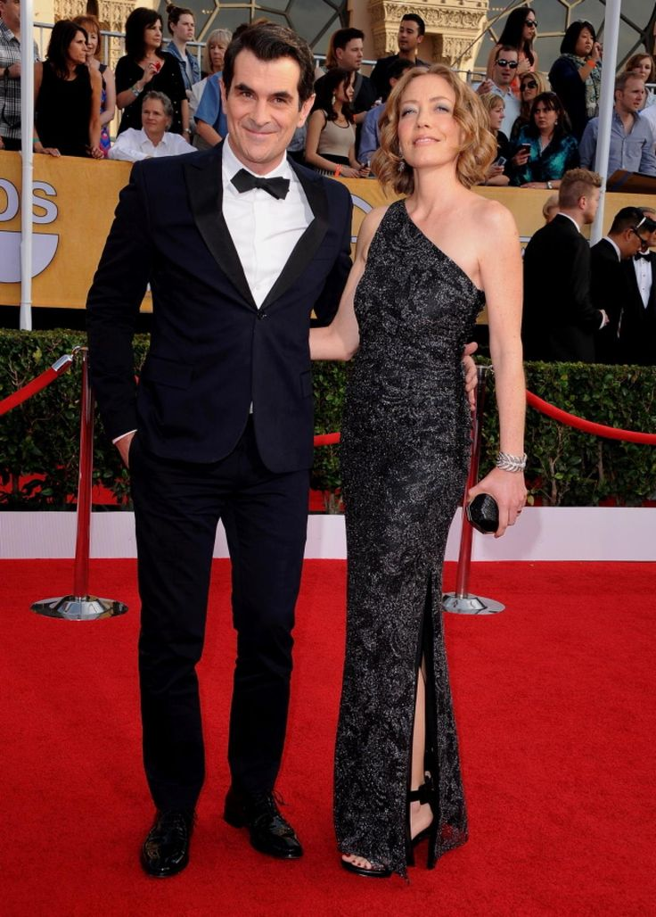 """""""Modern Family"""" actor Ty Burrell and his wife Holly wore the perfect awards show combo -- a dapper tux with satin lapels for him, and a glamorous black and silver gown for her. Ty Burrell won the award for Outstanding Performance by a Male Actor in a Comedy Series for his role as Phil Dunphy on """"Modern Family."""""""