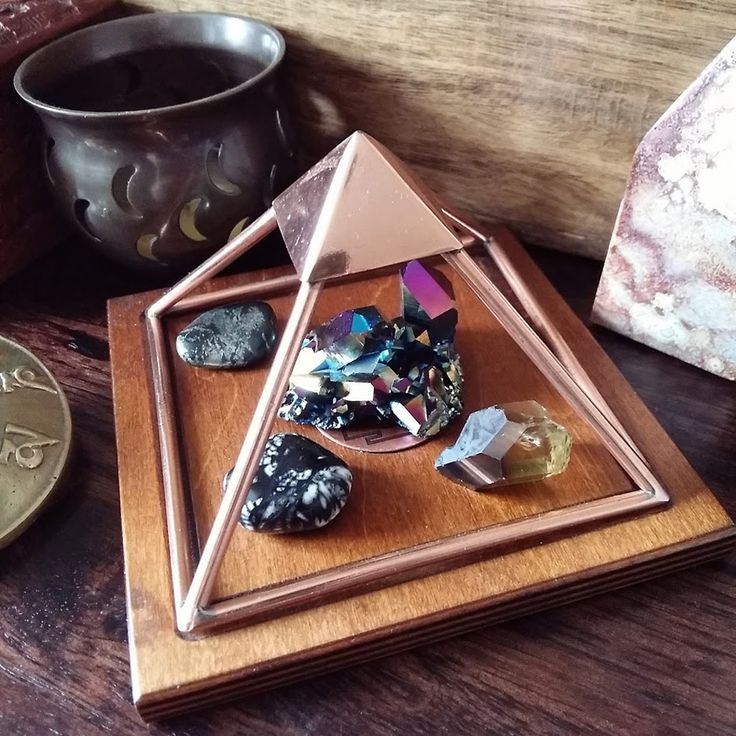 Crystals for empaths sitting in a copper charging pyramid on my crystal Altar