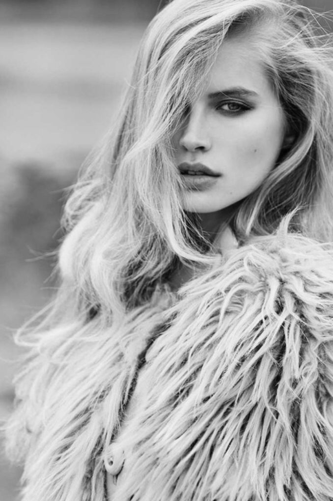 Great black and white fashion headshot. Love having half the model's facial features covered.