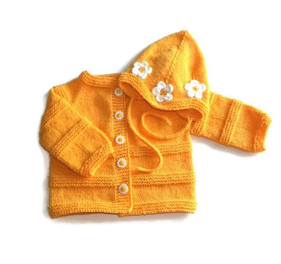 Knitted newborn coat and cap yellow with white flowers. $67, pick your color! baby set  yellow newborn jacket and pilot hat MADE TO ORDER by Tuttolv on Etsy.