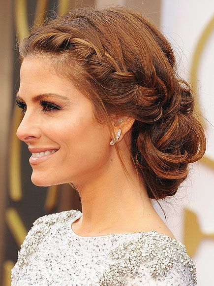 Maria Menounos Oscars 2014: french braids to behind ear, bottom section separated into three. middle becomes messy bun, sides braided. loosely draped and pinned