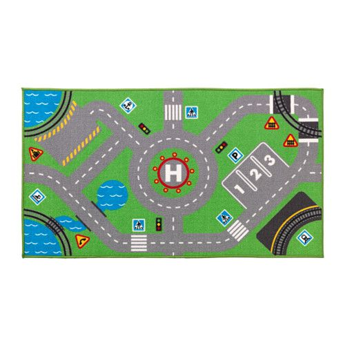 IKEA - STORABO, Rug, , Honk and drive! On this rug there are roads, parking spaces, traffic signs and railroads – just like in a city. Perfect to use with toy cars and figures from the LILLABO series.The rug's thick pile dampens sound, creating a snug feeling, and is soft to walk on.Children