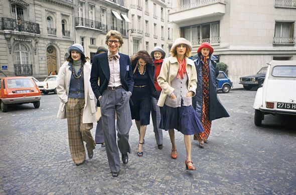 Yves Saint Laurent with models in looks from his fall 1972 collection