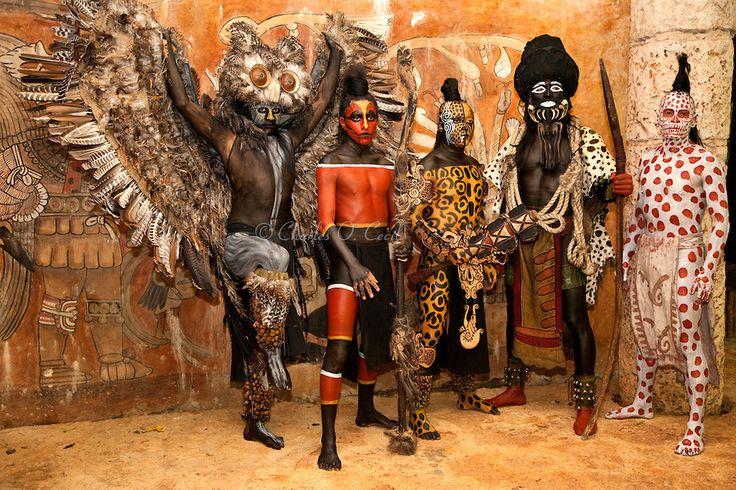 Dancers Representing Mayan Gods (L to R) Owl, Rattle Snake (Coral Snake), Ek Balam (Jaguar, the Warrior), Ek Chuah (Cacao), Ah Puch (White Death).  Xcaret, Riviera Maya, Yucatan, Mexico.