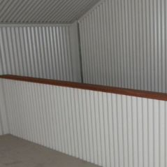 Internal stair well sheeted with corrugated iron