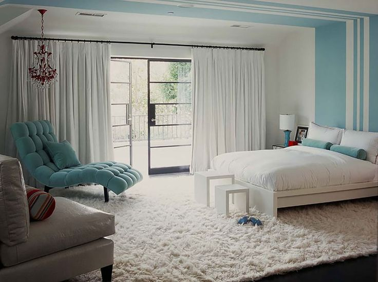 Design a modern bedroom with cool colors and stylish furniture.