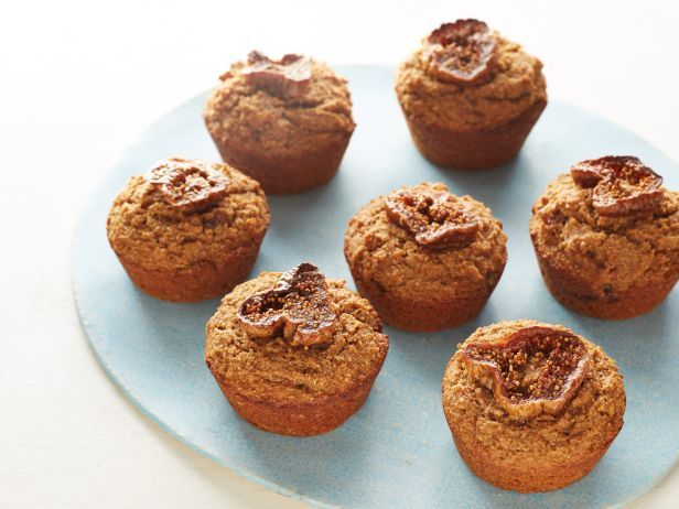 Fig Bran Muffins : At last: moist muffins that will help erase memories of all of the rubbery low-fat muffins that have come before them. One of the secrets is the applesauce, which helps yield a tender texture and a sweet fruity flavor. The figs on top add a sophisticated touch.