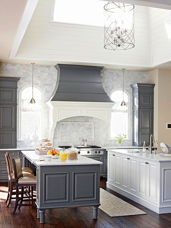 The combination of gray and white in this kitchen is soothing and modern. Marble on the countertops and the main wall plays perfectly with the color scheme./