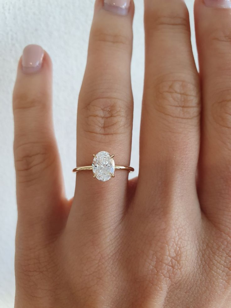 A perfect custom 1ct VSI1 Oval Solitaire set in 18ct Yellow Gold with the most brilliant sparkle.