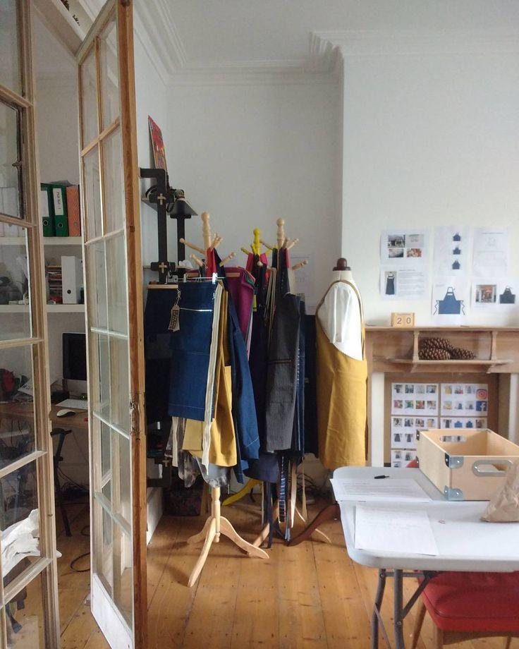 Getting ready for Open Studio. All the aprons hanging in a huddle! #adoglikesparky #apronmaking #denim #denimapron #studio #openstudio #SEMC17 #LDF17