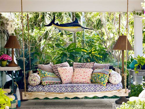 Mix and match patterned pillows on a swinging daybed.
