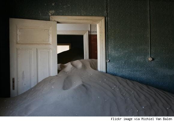 Location: Kolmanskop, Namibia  Story: Once a successful diamond mining community, Kolmanskop is now a desert ghost town where the houses welcome only sand.