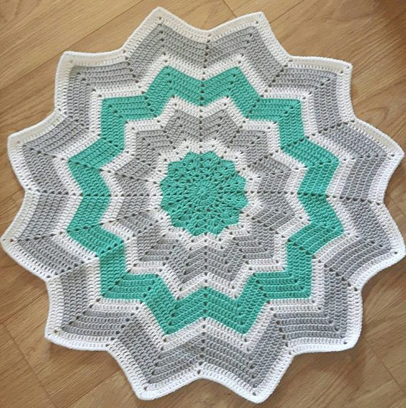 Beautiful star shaped crochet blanket. The mint, grey and white colour combination make it ideal for a boy or a girl.  Whether it's for a new baby gift, birthday gift or just because, this blanket will treasured for years to come.    You can make this yours at https://www.etsy.com/uk/listing/524449657/crochet-blanket-baby-blanket-crochet  If you would like one made to order in different colours, please message me on my etsy account.