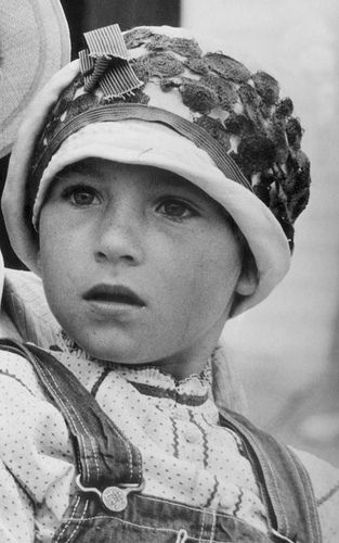 Tatum O'Neal in 'Paper Moon' - - - Her real father, Ryan O'Neal, played her father in this movie.  They did not get along at all.  Many fights.