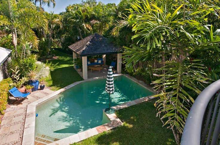 Large private saltwater pool and gazebo set in lovely tropical gardens in a quiet location. Very Private and pristine. #PortDouglasVilla #PortDouglasLuxuryAccommodation www.OzeHols.com.au/42
