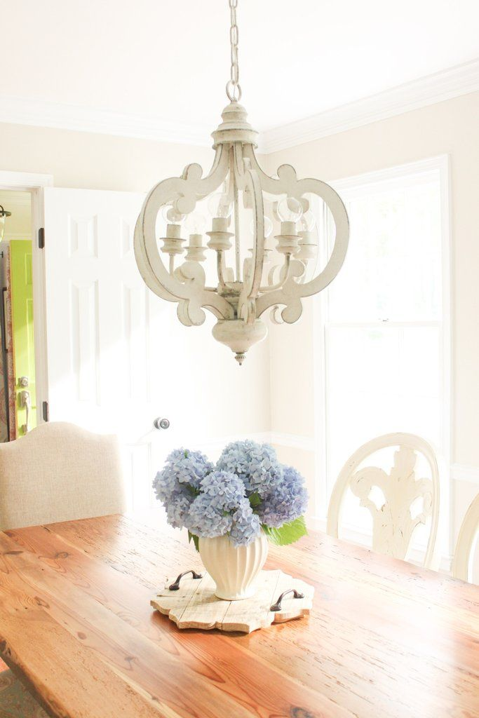This stunning chandelier will add an elegant touch to your home décor. Use it in your entryway, porch, hallways, dining room or eat-in kitchen. Finished in antiqued white with bluish grey undertones.