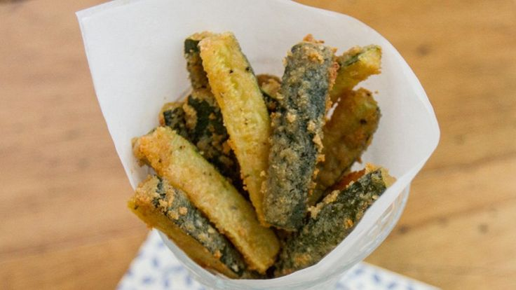 Coated in a crushed cereal and seasoning mixture and baked, these fresh zucchini sticks are a fun party appetizer.