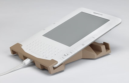 Kradle Kindle Stand. With this stand for the Kindle, you can catch up on Mashable over breakfast hands-free. It can be set to a 15-degree angle –- optimal for holding the device and reading, saving any strain on your wrists for other, less cerebral activities.