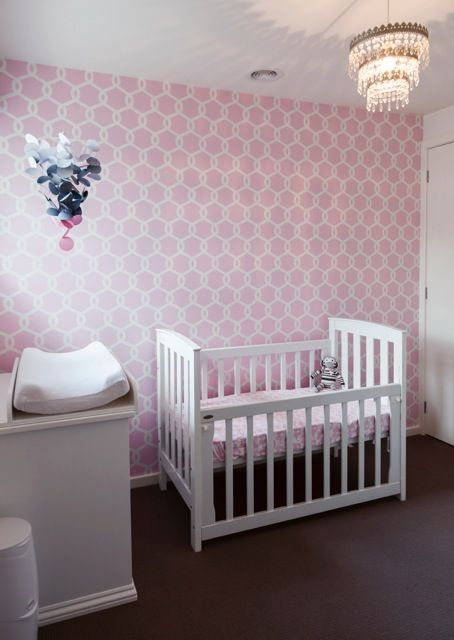 Pink Trellis - Add soft pink wallpaper and a vintage chandelier to illuminate the bedroom of your new born princess. Childrens nursery room interior designs by Little Liberty.