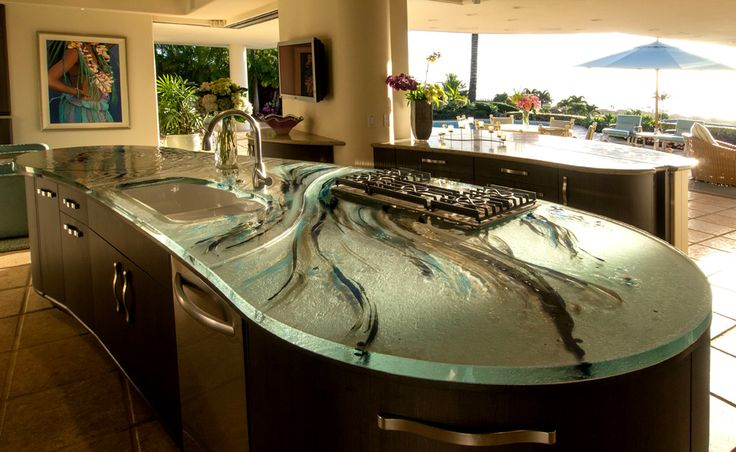 LOVE this countertop and kitchen.  The glass countertop is not only beautiful, but will really help prevent cross contamination.