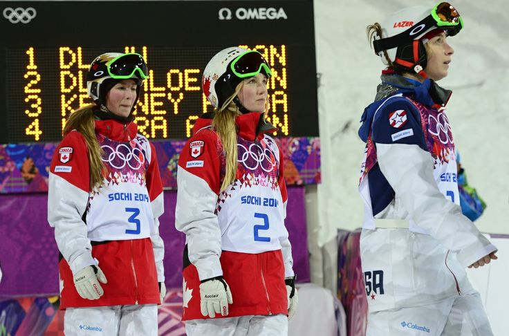 (L-R) Bronze Medallist, US Hannah Kearney; Gold Medallist, Canada's Justine Dufour-Lapointe; and Silver Medallist Canada's Chloe Dufour-Lapointe arrive for the Women's Freestyle Skiing Moguls Flower Ceremony at the Rosa Khutor Extreme Park during the Sochi Winter Olympics on February 8, 2014. AFP PHOTO / JAVIER SORIANO (Photo credit should read JAVIER SORIANO/AFP/Getty Images)