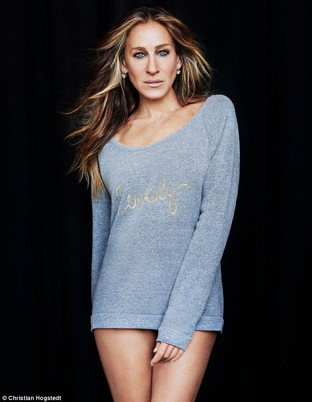 Baring all: Sarah Jessica Parker, 50, posed in a cadet blue sweatshirt with the word 'lovely' scrawled across in gold as a part of her new campaign celebrating the 10th anniversary of her first fragrance, Lovely