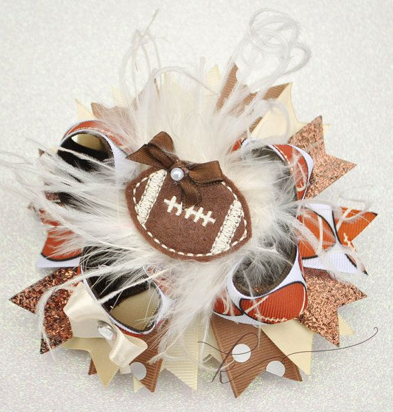 Handmade football boutique hair bow. Fun stacked boutique bow for your little cheerleading football princess. Featuring an embroidered felt football