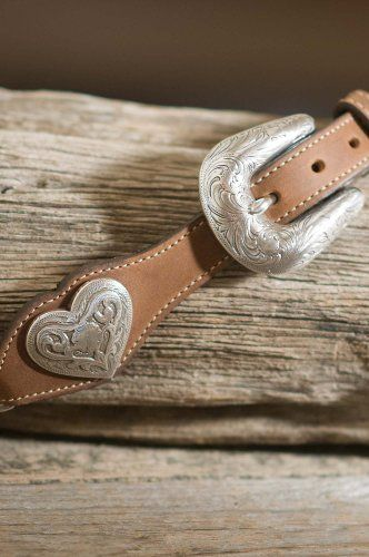 Linked Hearts Leather Belt, AGED BARK, Size 30 Made by #Overland Sheepskin Co Color #Aged Bark. 1 1�2'' at widest point. Made of smooth leather and tooled metal hearts. Delightful with dress slacks and just right with jeans. An ornately tooled buckle adjusts for the perfect fit. Made in the U.S.A